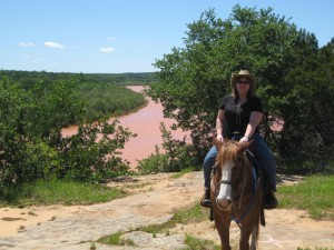 Luxury Travel Writer Nancy D. Brown goes horseback riding along the Brazos River at the Wildcatter Ranch. Horseback riding is one of the many things to see and do in Graham, Texas.