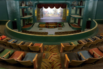 Inside the historic Opera  House Theatre where  live theater means belly laughs fun