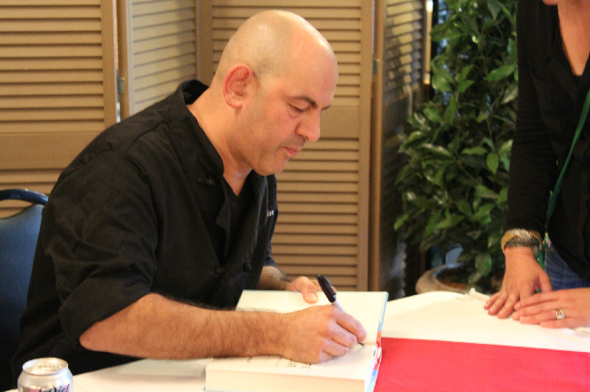 simon signing book