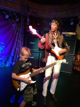 Roman jams with Jimi at Madame Tussauds.