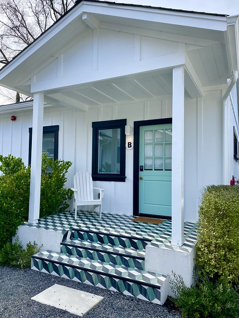 Bungalow B at Calistoga with seafoam green Dutch door and eye-popping tile on the back porch.
