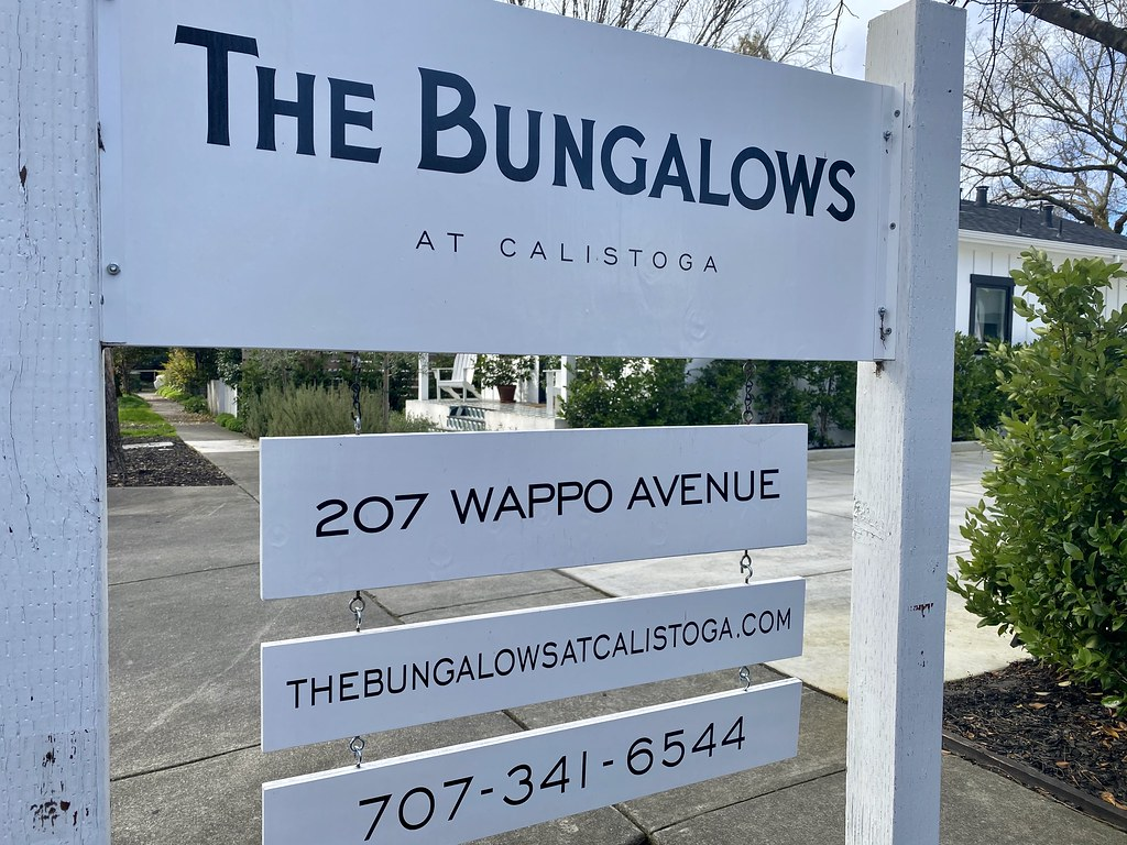 The Bungalows at Calistoga sign with address and phone number outside the boutique hotel.