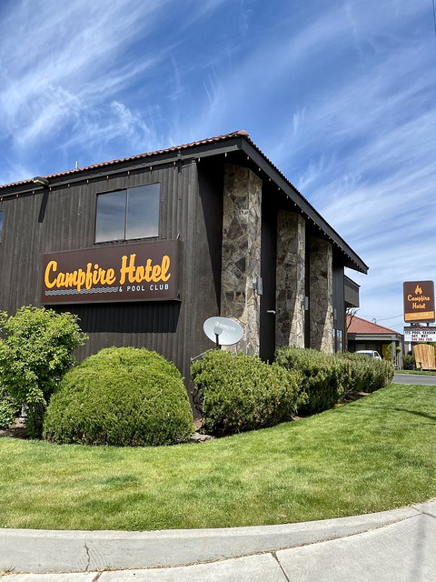 Campfire Hotel & Pool Club front entrance has a grassy lawn for dog walking.