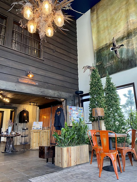 The lobby at Campfire Hotel Bend feels like a rustic lodge with its camp store and fake pine trees.
