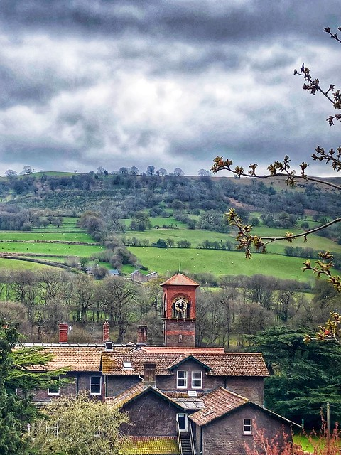 gliffaes country house hotel clock tower, brecon beacons countryside, crickhowell south wales