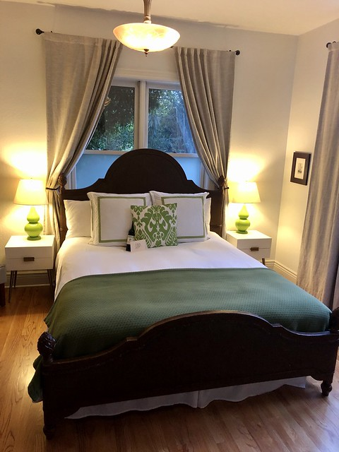 King size bed, framed by two lamps in the Sangiovese Room at the Grape Leaf Inn, Healdsburg, California.