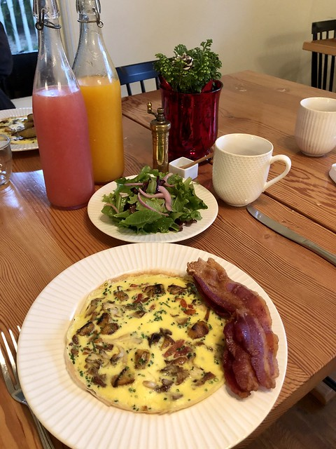 Mushroom and garlic frittata with bacon, salad and fresh juice served at Grape Leaf Inn.