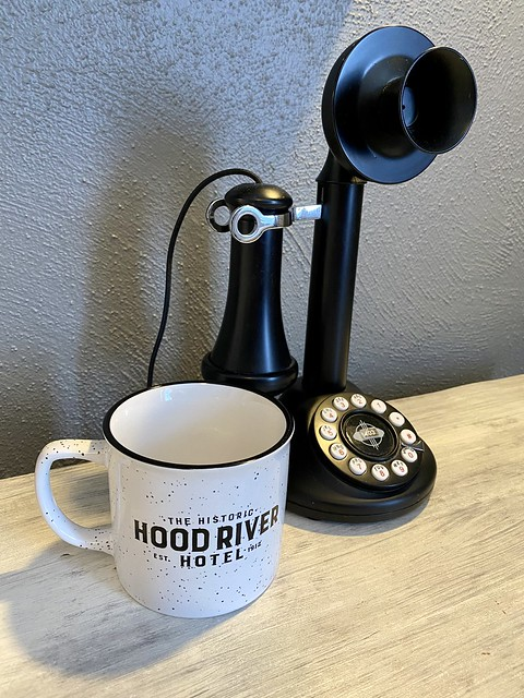 Historic Hood River Hotel mug and retro black and white telephone match vintage interior decor.