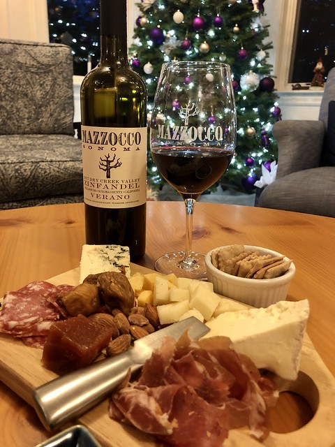 Mazzocco Sonoma Zinfandel bottle & wine glass, with cheese & charcuterie platter for Grape Leaf Inn wine hour.