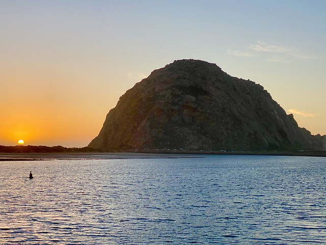 Morro Rock sunset from Salty Sister Hotel in Morro Bay, California.