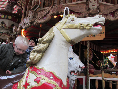Riding a carousel horse in Germany. Photo © 2014 Nancy D. Brown