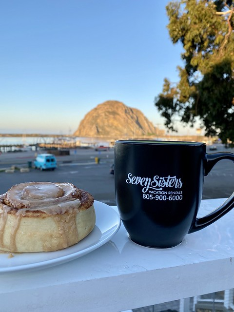 Cinnamon roll and coffee on the hotel rooftop with a view of Morro Rock, across the street.
