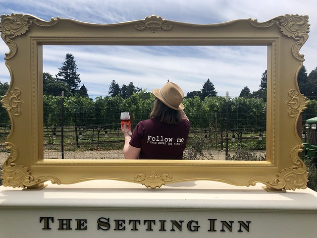 "Nancy D. Brown wearing her ""Follow Me, I Know Where the Wine Is"" t-shirt in the backyard of The Setting Inn Napa Valley."