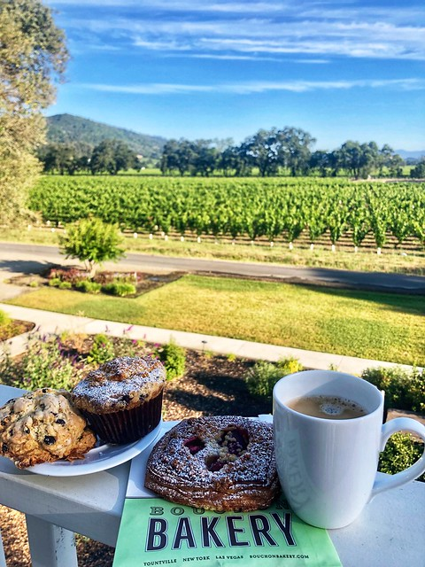 Pastries, coffee mug and Napa Valley vineyard views in Napa, California.