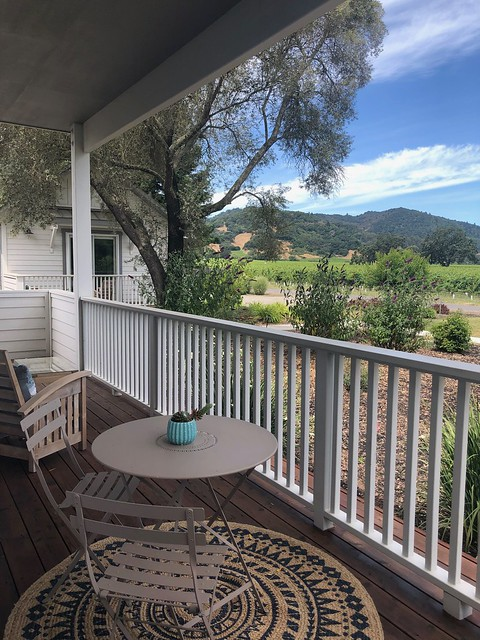 Relax on your private deck, with vineyard views at The Setting Inn.