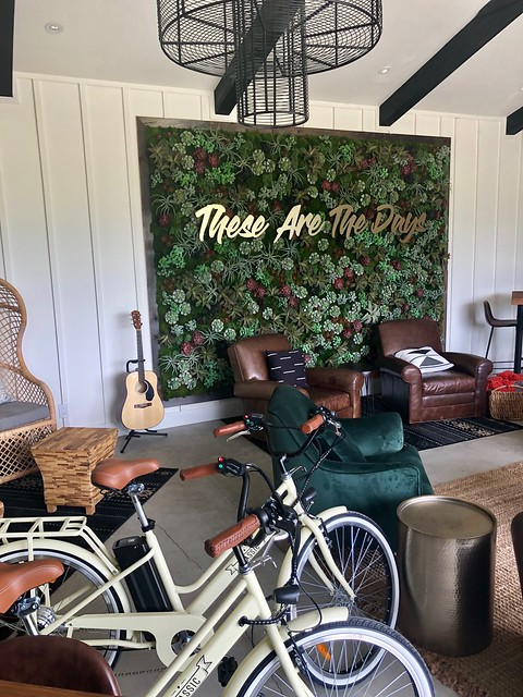 The Setting Inn barn is a common area, out back, with an indoor outdoor feel. Chairs, guitar, electric bikes and television create the entertainment center.