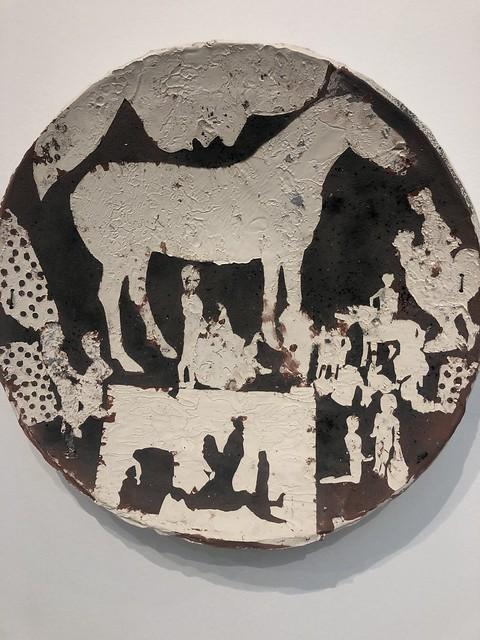 Ceramic plate of horse and men on display at di Rosa art gallery in Napa, California.
