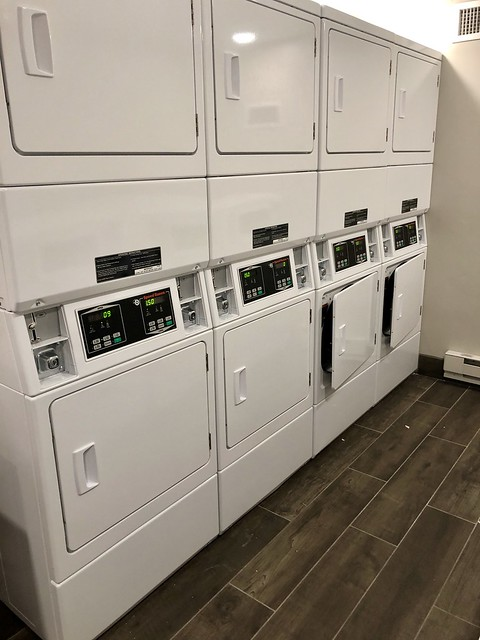 Four washing machines and dryers at the Wilson Hotel.