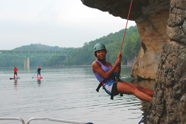 Paddle boarding, climbing and enjoying watching at the same time